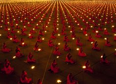 100,000 Monks Praying for Peace Taken by photographer Luke Duggleby at the Dhammakaya Temple in Thailand.