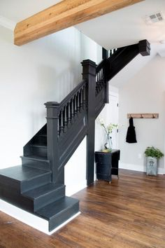 Chip and Joanna Gaines take on their biggest Fixer Upper to date when they help furniture designer Clint Harp and his wife Kelly turn a ready-for-the-wrecking-ball junk-heap of a house into a beautifully restored gem. Harp Design Co, Black Staircase, Staircase Design, Black Banister, Joanna Gaines, Painted Staircases, Iron Stair Railing, Banisters, Railings
