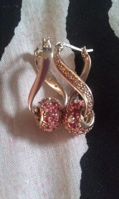 My chamilia earrings w/ the beads in them! Just for u Sandie!
