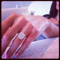 set with a 3.00 Carats Cushion Cut diamond inside a seamless diamond