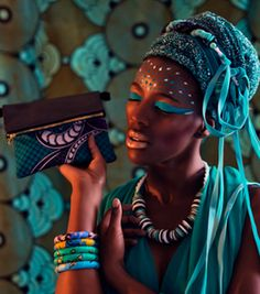 One of Each African accessory brand small blue print clutch bag in fashion editorial Photo: Claire Gunn