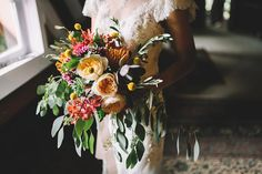Colourful mixed rustic bouquet. Photo by Fire, Wood and Earth Photography. www.theweddingnotebook.com