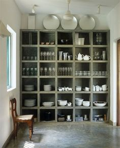 12 Concrete Interiors: Concrete cubbies might not be your first choice for storing porcelain, but the chunky concrete shelving unit is gorgeous. The floor in the kitchen of this house in Sri Lanka, by architect Geoffrey Bawa, is polished concrete too. Kitchen Shelves, Kitchen Pantry, New Kitchen, Kitchen Storage, Pantry Storage, Open Pantry, Kitchen Dishes, Dish Storage, Glass Shelves