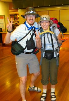 Don socks with sandals to be a funny tourist couple on Halloween.