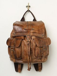 Fashion accessories: brown leather bag, backpack, casual style, vintage, Rugged, Masculine.