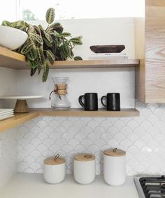 11 types of white kitchen splashback tiles: Add interest with shape over colour. Fishscale tile, white fishscale tile
