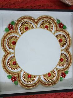 Kundan rangoli around plate or Diya (Samai)