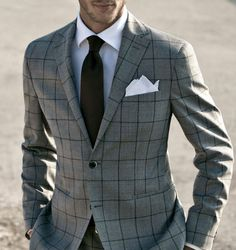 gray windowpane fitted suit. classic white oxford. rust brown tie. white pocket square. smart. style.