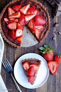 This Strawberry Chocolate Tart is filled with whipped vegan chocolate ganache and topped with fresh strawberries, all piled in a chocolate crust. This easy treat is gluten-free, grain-free, Paleo, and vegan.
