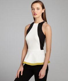 5c1d33217d4473 Wyatt   black and white colorblocked jersey peplum scuba top   style    321899801