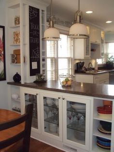 for my house... this with cabinets on the kitchen side.  bar seats at counter height on the family room side