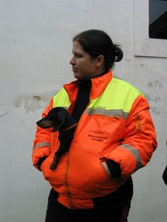 Rita, member of the Hungarian rescue team 'Életjel Mentőcsoport' from Szolnok, and Smile, the dachshund. Search And Rescue Dogs, Team S, Dachshund, Bomber Jacket, Smile, Weenie Dogs, Weiner Dogs, Dachshunds, Bomber Jackets