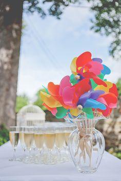 Colourful wedding favour windmills!  http://thetwinsweddings.co.uk/