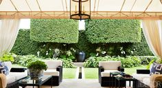 A wall of lush green is the focal point of Laura and Harry Slatkin's quietly elegant tented veranda in Palm Beach. Photo by Oberto Gili. Outdoor Rooms, Outdoor Living, Outdoor Furniture Sets, Outdoor Decor, Wicker Furniture, Indoor Outdoor, Custom Home Builders, Custom Homes, Fresco