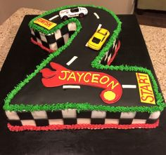 Race track cake with cars