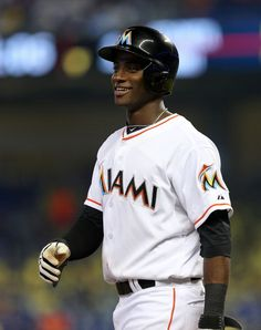 News Photo : Adeiny Hechavarria of the Miami Marlins looks on...