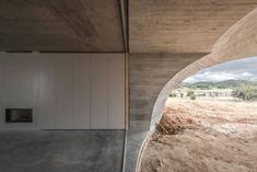 A flat-topped residential property with an inverted dome earmarks 'House In Monsaraz', which local architecture firm Aires Mateus has designed in the Portuguese town of. Cabinet D Architecture, Architecture Design, Sliding Glass Windows, Houses In Germany, Monsaraz, Circular Patio, Journal Du Design, Hillside House, Concrete Forms