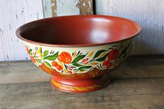 """Estate sale find along with some other painted items.Nicely executed tole painted fruit bowl or compote. Bittersweet background with off white, bittersweet, gold and green decoration of fruit,leave and berries. Interior is also bittersweet color. It measures 9"""" diameter and 4"""" high $39"""
