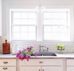 Grey grout subway tile, white shaker cabinets and 2 windows- our kitchen will be like this!