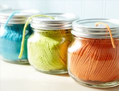 Small glass jars are great for keeping spools of yarn or string accessible and tangle-free. Punch or drill a hole through the metal lid. Then put the spool in the jar and run the string through the hole before you screw on the lid.
