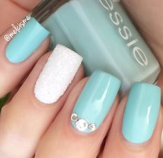 Baby blue manicure with snowy accent