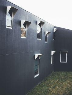 Dark facades with white aluminum frames in Australia