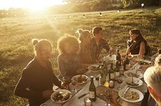 Shot of a group of family and friends enjoying a late afternoon outdoor meal…