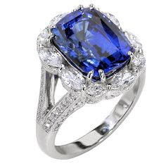 8.73 Carat Cushion Cut Sapphire Ring Surrounded by Marquise Diamonds