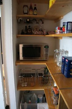 Dan's Kitchen: The Big Reveal — Renovation Diary love the microwave in the pantry for more counter space, plus the wire baskets and shelves utilizing the corners!