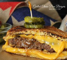 Looking for a fun new twist on burgers? This burger recipe uses two grilled cheese sandwiches as the buns, a perfect summer barbecue idea. Grilled Cheese Burger, Grilled Burger Recipes, National Grilled Cheese Day, Sandwich Recipes, Grilled Cheeses, Cheese Buns, Good Food, Yummy Food, Tasty