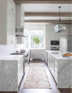Simple Kitchen with Waterfall Edge Countertops