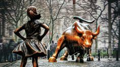 The Fearless Girl statue of a little girl, with hands on her hips, standing up to the iconic bronze Charging Bull near Wall Street and New York Stock Exchange in Lower Manhattan as part of the International Women's Day 2017. Buy fine art canvas prints, framed prints, acrylic or metal prints of New York City photos by Nishanth Gopinathan. Perfect as wall decor for your home or office.