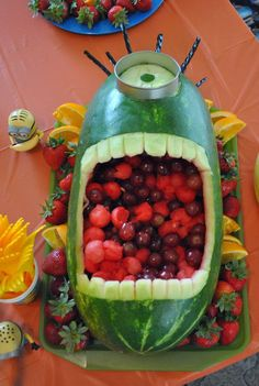 A Minions carved watermelon fruit bowl will take over the snack table at your next kid- friendly summer party. Fill with their favorite types of melon, apple and more. Don't forget the black licorice for the hair!