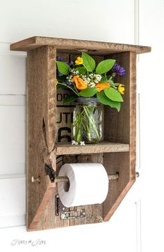 Unique bathroom accessories - This rustic/country/farmhouse wall toilet paper holder can be made with reclaimed wood or pallet wood.