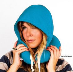 Inflatable Hoodie Pillow, $20 | 21 Travel Accessories That Will Make Your Life So Much Easier