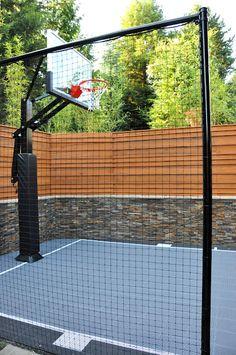 Small basketball court in backyard