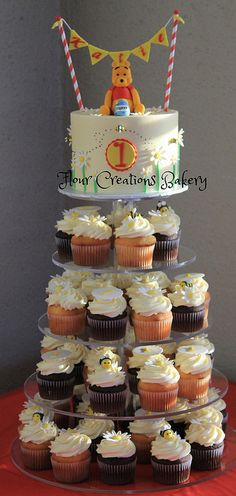 Winnie the Pooh First Birthday Cake and Cupcakes