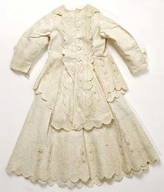 Dress  Date:     1880–89 Culture:     American Medium:     cotton Dimensions:     (a) Length at CB: 18 in. (45.7 cm) (b) Length at CB: 19 in. (48.3 cm) Credit Line:     Gift of Mrs. Phillip H. Gray, 1950 Accession Number:     C.I.50.105.10a, b