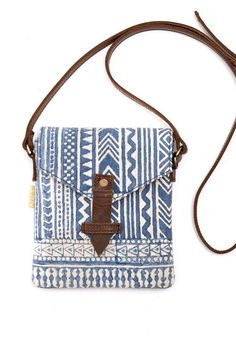 A stunning, slender crossbody featuring tribal designs perfect for keeping your belongings right at your side.
