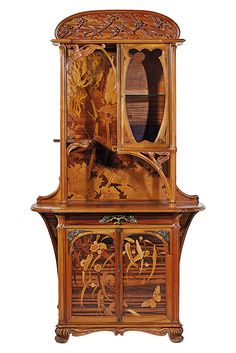 EMILE GALLE (1846-1904) 'AUX LIBELLULES', A RARE VITRINE, 1900-03 carved walnut, rosewood, burr elm, ash, pearwood, atapa and other marquetry inlay, bronze, carved with dragonflies and with butterfly mounts 82 7/8 in. (210.5 cm.) high; 49 ¼ in. (125 cm.) wide; 22 in. (56 cm.) deep inlaid signature Gallé