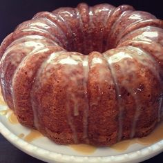 Brown sugar bundt cake with pecan and toffee mixed inside and a caramel drizzle on top!