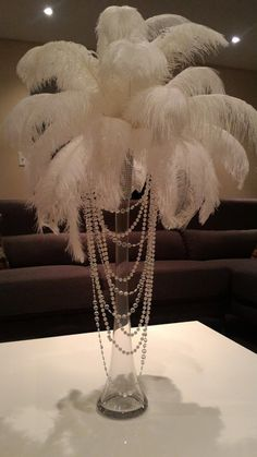 Ostrich Feather Centerpiece with Acrylic and Pearl Garlands for a Vintage Roaring Look! - Informations About Ostrich Feather Centerpiece with Acrylic and Pearl Garlands for a Vintage Roarin - Roaring 20s Party, Gatsby Themed Party, Roaring 20s Wedding, Great Gatsby Wedding, 1920s Wedding, Party Wedding, Pearl Themed Party, Wedding Ideas, Pearl Party