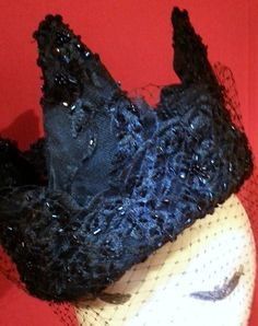 This black beaded lace on buckram took all night to complete. Its topped off with a french silk veil for the final touch.