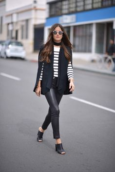 Cape, striped sweater, leather pants and mules