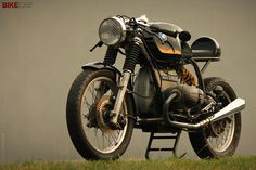 1970s-era BMW airheads respond well to the cafe racer treatment. But you don't often see one with a mono-shock conversion. This 1976 R75 is owned by graphic designer Casey Wilkinson, and it's one of 13 bikes featured in the 2014 Bike EXIF Custom Motorcycle Calendar.   Get yours from https://www.octanepress.com/book/bike-exif-custom-motorcycle-calendar-2014