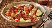 Ingredients  1 pkg. Hillshire Farm® Smoked Sausage, cut into 1/2-inch slices 1 red bell pepper, seeded, chopped 1/4 cup sweet chili garlic sauce 1 cup fresh pineapple, cut into 1/2- inch pieces 3 cups cooked rice Directions  COOK and stir sausage and bell peppers over medium-high heat for 5 minutes or until  sausage is lightly browned and peppers are tender. ADD chili garlic sauce and pineapple; cook and stir for 5 minutes. SERVE over cooked rice.