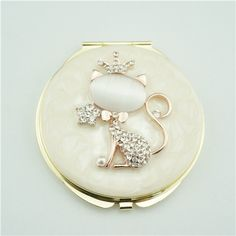 Crystal compact mirror/Cat compact mirror This little cat compact mirror is a perfect gift for lady. It is covered with ivory enamel glaze and mounted with bling-bling crystals and elegant pearls. There are two mirrors inside.