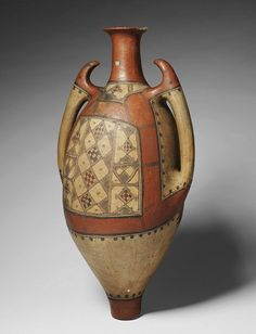 African  Water vessel. A ceramic jar which is  worn by women on their backs to fetch water from wells and springs and then to store it in their homes.  Ouadhias culture. Great Kabylia, Algeria