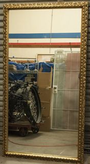 EXTRA LARGE MIRROR WITH ORNATE GOLD PAINTED WOOD FRAME. MEASURES 42 IN. X 77 IN.
