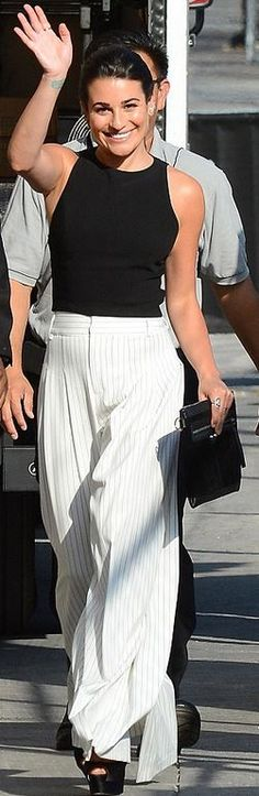 Who made Lea Michele's black tank top, platform sandals, white stripe pants, and clutch handbag? Business Clothes, Business Outfits, Celebrity Style Casual, Stripe Pants, Dressy Pants, Fashion Dictionary, Lea Michele, Black Tank Tops, Alice Olivia